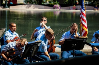 The USAF violin section rests between pieces at the concert. (Charles Mitchell/Bloc Photographer)