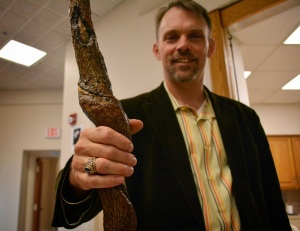 English professor Christopher Crane poses with his handcrafted staff. (Jin Kim/Co-Managing Editor)
