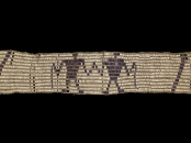 This Wendat (or Huron) belt produced some time between 1600 and 1650 is similar in to the Kaswentha, or two row wampum belt, that begins and ends the exhibit. While it features very different images, its images still symbolize an agreement between the U.S. and an American Indian nation. (Photo courtesy of the National Museum of the American Indian/Photo by Ernest Amoroso)