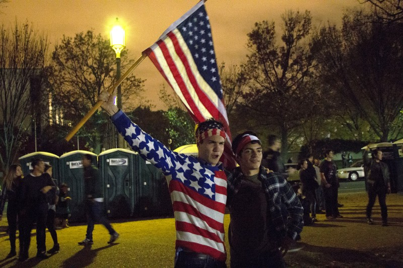 George Washington University students Jopus Grevelink and Angel Valencia show their support. (Trey Sherman/Bloc Reporter)