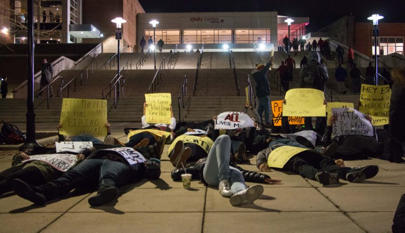 Around 9 p.m., student activists walked from Stamp to the Xfinity Center, an effort that attracted the attention of passersby. (Sung-Min Kim/Bloc Photographer)
