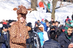"""I pretty much woke up, trying to eat my leaves on the branch, but they were frozen so I said dang I'm going to try my luck out here. But then I realized I'm a giraffe and have no thumbs so I couldn't throw a snowball. I'm just trying to do the best I can."" - Nathan Markovitz, junior criminal justice major. (Julia Keane/Bloc Photographer)"
