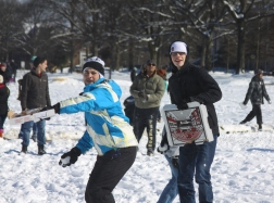 Nick Ewing winds up to chuck another snowball, as Ross Baehr attempts to defend himself with part of a pizza box. (Jack Angelo/Bloc Photographer)