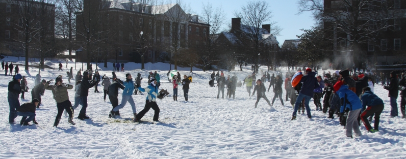 Two groups of students exchange blows in the middle of McKeldin Mall as snowballs fly around them. (Jack Angelo/Bloc Photographer)