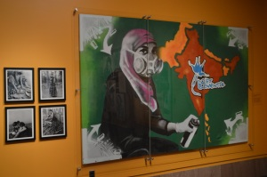 This untitled graffiti mural created by artist collective Art Under Pressure was first featured in the District's first desi hip-hop show, Drift Elemental. The mural is now hung on the walls in the Smithsonian National Museum of Natural History's Beyond Bollywood exhibit. (Brittany Britto/Bloc Reporter)