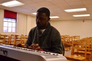 Working as a maintenance worker for the university, Deville Desir develops his music in his free time. (Aiyah Sibay/Bloc Reporter)