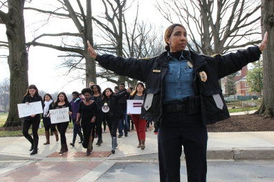 Police patrolled the scene while protesters continued to march. (Trey Sherman/For The Bloc)