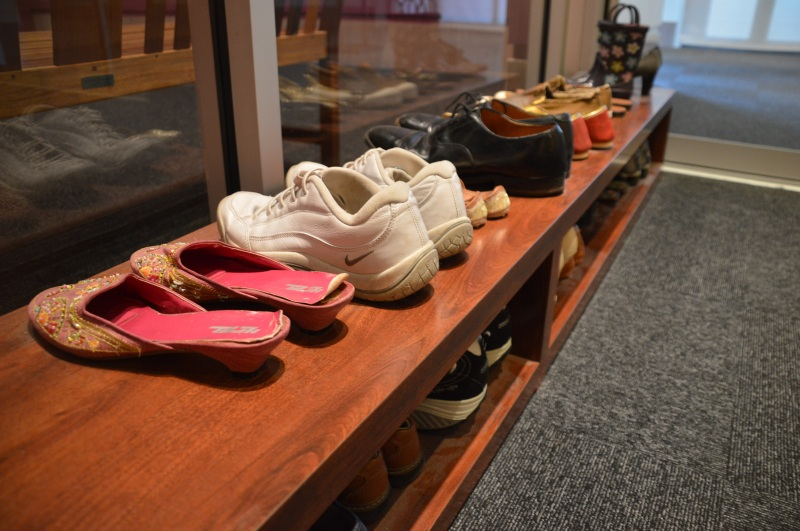 The Beyond Bollywood exhibit's entrance features an assortment of shoes, reflecting an Indian custom to remove footwear before entering a home. (Brittany Britto/Bloc Reporter)