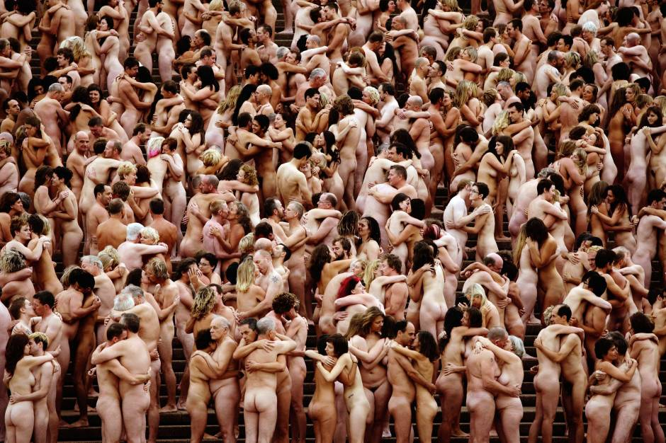 """Nude members of the public take part in """"Mardi Gras: The Base,"""" an art installation by artist Spencer Tunick, at the Sydney Opera House on March 1, 2010. (Photo by Brendon Thorne/Getty Images)"""