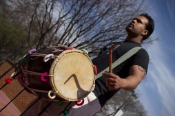 Zubin Chabra plays his dholak in cadence with the DJ's set. (Ryan Eskalis/For The Bloc)