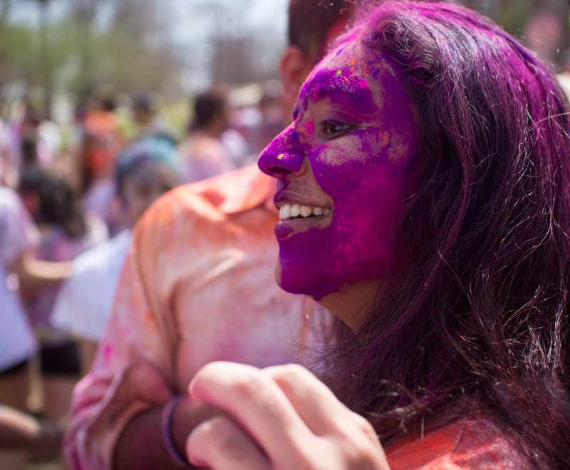 "Students' faces are caked with ""gulal"" during the celebration. (Ryan Eskalis/For The Bloc)"