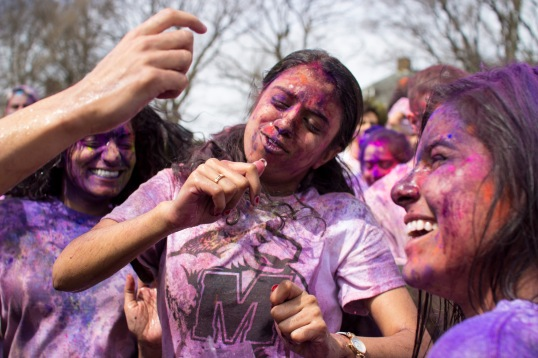 Students dance continually throughout the Holi celebration. (Ryan Eskalis/For The Bloc)