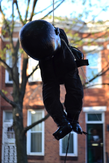 """Dolls painted black are the """"Strange Fruit"""" hanging from a tree. (Aiyah Sibay/Bloc Reporter)"""
