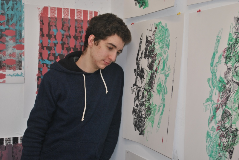 Artist Eric Gabriel stands surrounded by his works. (Alana Pedalino/For The Bloc)