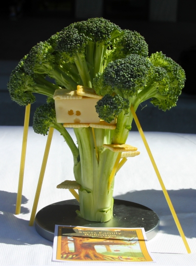 """Aaron Ginoza recreates """"Swiss Family Robinson's"""" cover with broccoli, Swiss cheese and crackers. (Jack Angelo/Bloc Reporter)"""