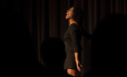 """Ceaira Thomas performs """"I was There in the Room."""" Her character expresses exuberance for the act of a woman giving birth. (Ryan Eskalis/Bloc Reporter)"""