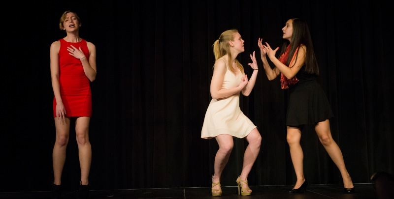Erin Kemp (left), Sarah Sherman (middle) and Kayleigh Torok (right) perform the opening skit for the Vagina Monologues at UMD. They personify the emotions a vagina would have.  (Ryan Eskalis/Bloc Reporter)
