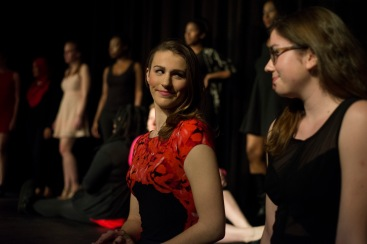"Erin Klatt (left), one of the co-coordinators for ""The Vagina Monologues"" at UMD, sits with Carly Moore (right) on stage for the skit ""The Woman who Loved to Make Vaginas Happy."" (Ryan Eskalis/Bloc Reporter)"