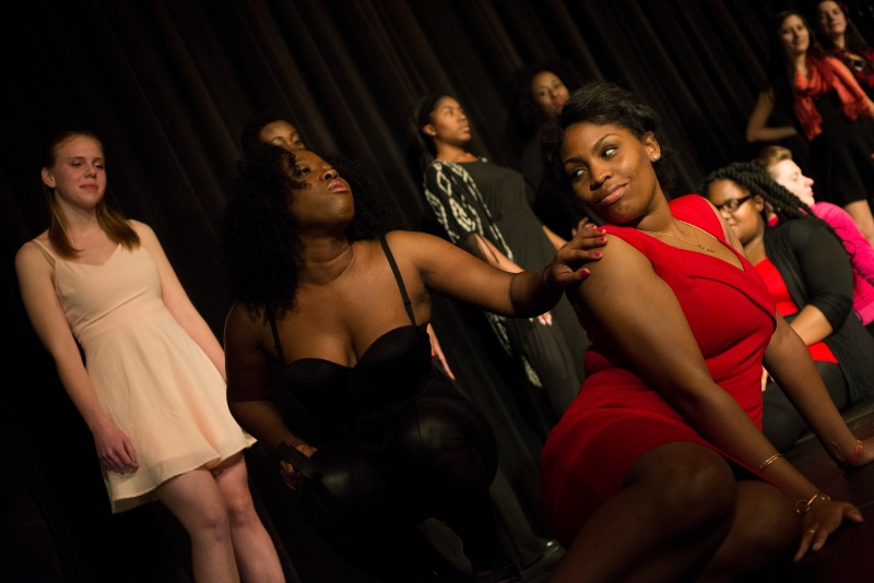 Jasmine Green (left) performs as a female dominatrix. She strokes Tuesday Barnes's (right) as she describes the different ways she elicits moans from her subjects. (Ryan Eskalis/Bloc Reporter)