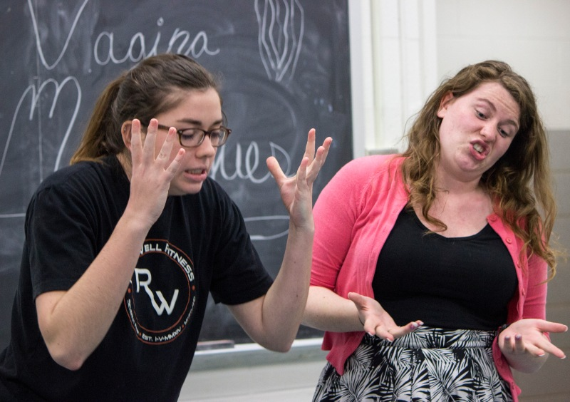 Carly Moore (left) and Camille Veselka (right) rehearse a comedic monologue in which the word clitoris invokes confusion. (Ryan Eskalis/Bloc Reporter)