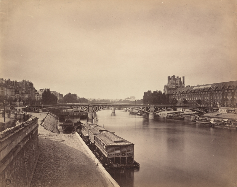 "The people in Gustav Le Gray's ""La Pont Du Carrousel, Paris…"" are visible only as shadowy forms due to early cameras' inability to capture quickly-moving objects with their high exposure times. (Image courtesy of the National Gallery of Art)"