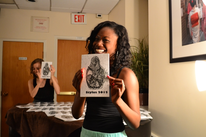 Lenaya Stewart, the poetry board editor, and Lyla Lawless, the prose board editor and copy editor, unveil the 2015 edition of Stylus. (Aiyah Sibay/Bloc Reporter)