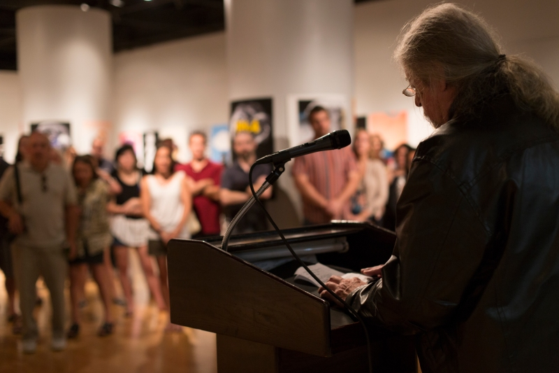 "Jim Thorpe, curator of the ""Questioning the Bomb"" art gallery and University of Maryland art professor, gives thanks to everyone who helped him put together politically charged exhibition. (Ryan Eskalis/Bloc Reporter)"