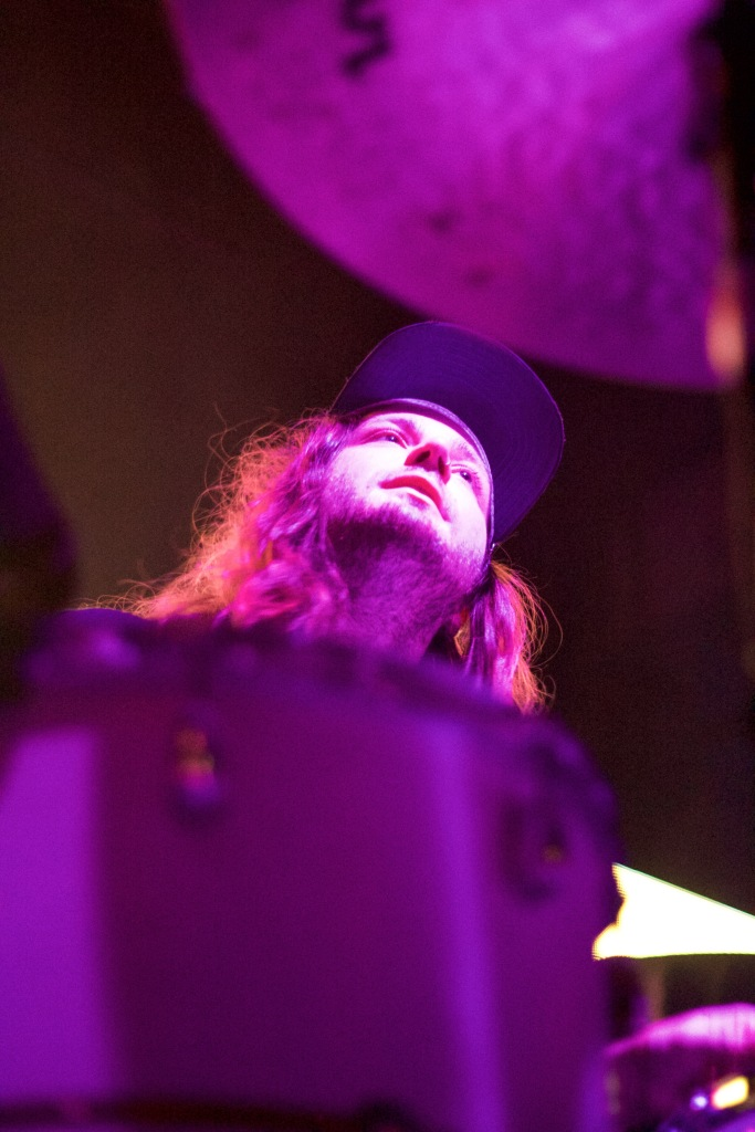 The drummer of Hunny, Joey Anderson, looks out into the audience from behind his drum set. The band opened for Bad Suns and The Neighbourhood at the 9:30 Club on Tuesday, 9/29. (Julia Lerner, Bloc Reporter)