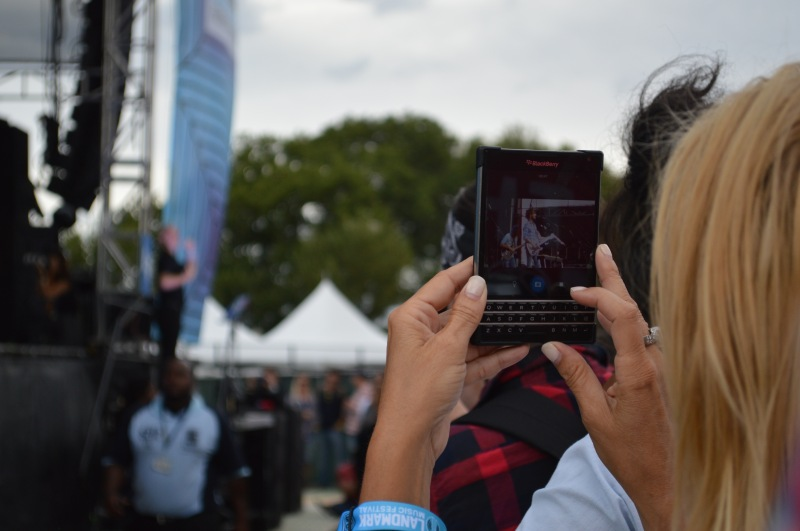 An attendee takes a video of Band of Horses during their set. (Iman Smith/Editor-in-chief)