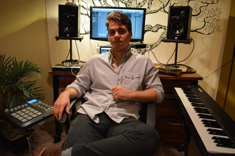 Dean Emerson, sophomore jazz performance major, in his bedroom studio. (Cassie Osvatics/Writer's Bloc Reporter)