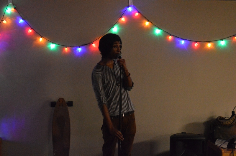 Kosi Dunn, junior film major, warming up the crowd before the Terpoets open mic began. Kosi is the black student involvement intern in the MICA office as well as the president of Terpoets. (Cassie Osvatics/Writer's Bloc Reporter)