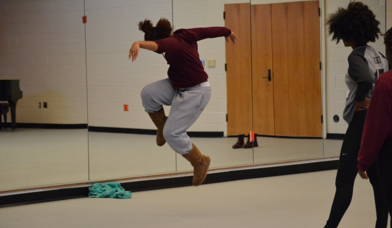 Executive director of the UMD dance group, Prima Dolls, Olivia Lynes as she demonstrates choreography. Olivia is a senior dance major and a premed student. (Cassie Osvatics/Writer's Bloc Reporter)