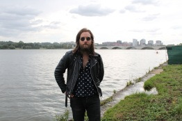 John Thornley, lead singer and guitarist of the D.C. band, U.S. Royalty, by the tidal basin in West Potomac Park. U.S. Royalty performed at the Miller Lite stage on Saturday at Landmark Music Festival. (Cassie Osvatics/Bloc Reporter)