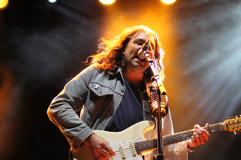 Adam Granduciel, the lead singer and guitarist for Philadelphia indie-rock band, The War on Drugs, during their performance, Saturday on the Miller Lite Stage. (Cassie Osvatics/Bloc Reporter)
