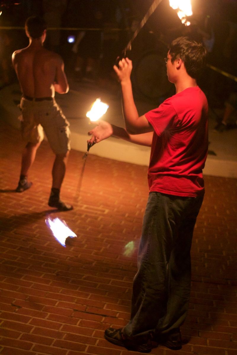 Matt Chin, a member of UMD's Juggling Club, spins fire before the lantern ceremony in the fountain. (Julia Lerner/Bloc Reporter)