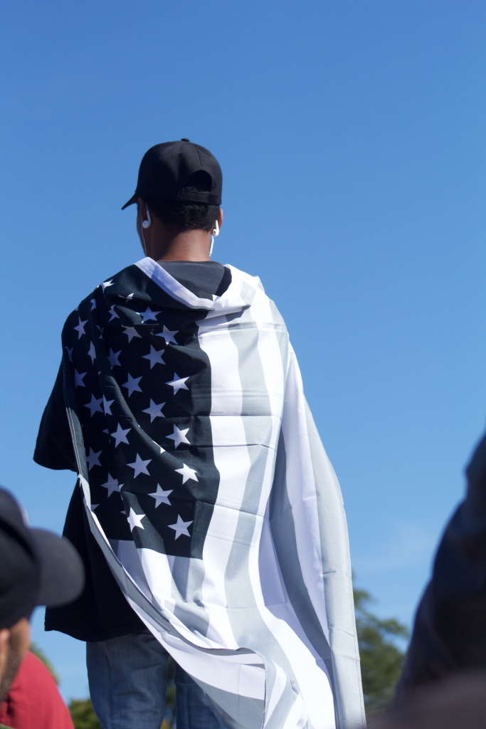 The black and white version of the American flag also made an appearance at the march. A symbol for the history of blacks in America, the flag is also used now to represent the economic and social inequality people face every day. (Julia Lerner/Bloc Reporter)