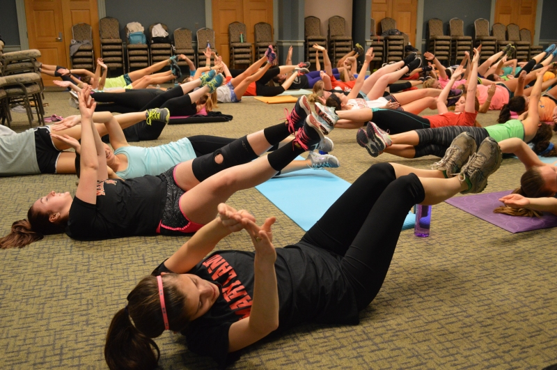 Female students working up a sweat and being liberated for the elliptical. (Cassie Osvatics/Bloc Reporter)