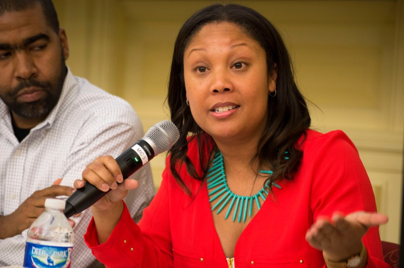 "Dr. Taharee Jackson (center), assistant professor of the minority and urban education program in the college of education spoke at the Black Lives Matter Town Hall meeting in the special events room of McKeldin Library to discuss the role of education in civil rights. When discussing solidarity with Black Lives Matter, she responded that ""[racisism] is in every institution"" and ""we need to think about the impact and power of quality research."" Pictured left, Julian Hipkins. (Cassie Osvatics/Bloc Reporter)"