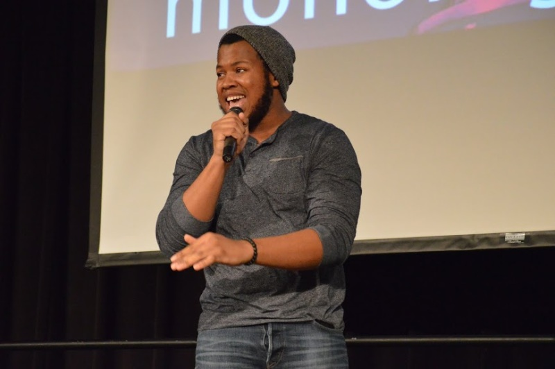 "Naim Owens, a 4th year sophomore and business major from PG County Community college, performing his song We're Human Too."" (Cassie Osvatics/Bloc Reporter)"