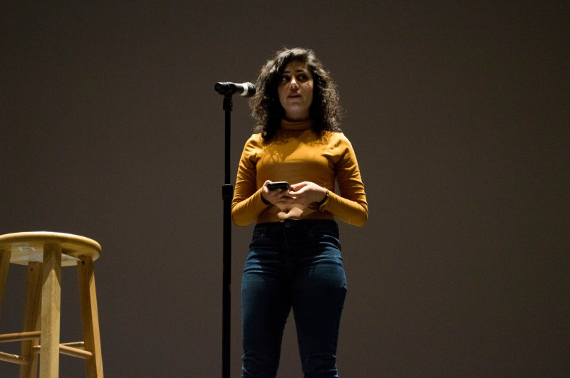 Senior English major Pegah Maleki, during her emotional reading at TerpSlam in the Hoff Theatre of Stamp. (Cassie Osvatics/Bloc Reporter)
