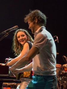 Vocalists and married couple from folk rock band David Wax Museum, Suz Slezak(left) and David Wax (right), during their loving performance at 9:30 club. The couple also brings their daughter, Calliope, along on tour. (Cassie Osvatics/Bloc Reporter)