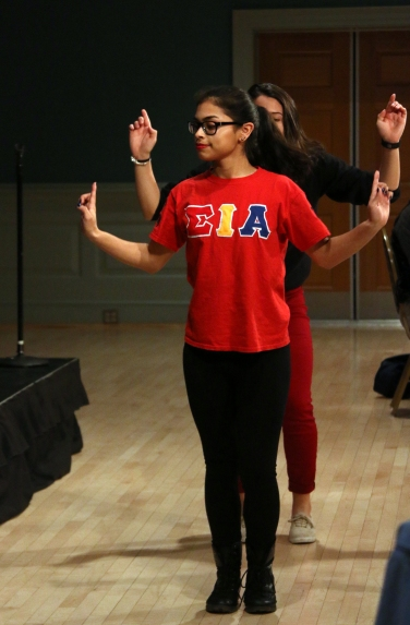 "Astrid Díaz and Aida Martinez, members of the Chi Chapter of Sigma Iota Alpha, demonstrate a popular type of dance in the black community called strolling during the ""My Black is Beautiful"" event in College Park, Md. on Feb. 25, 2016. (Jack Angelo/Bloc Reporter)"
