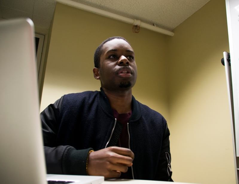 "Junior Environmental Science & Policy Major Daniel Jjemba, a participating member of Black Male Initiative sits down with me to talk about the mental health event. He says the thing that stuck out to him the most from the meeting was ""that black people do pay attention to these issues and we are trying to consciously get better. A lot of times it feels like nothing's going on, or like things aren't changing, but I feel like we will be able to go out into the world with our friends and people we know and we will be able to make mental health less stigmatized and more of an issue we'll be ready to tackle honestly instead of pushing aside for others and ourselves."" When asked why he attends weekly BMI meetings: ""I just like being around motivated, young black people, it's cool. Sort of like a support system for each other. no mattwer what we're talking about, we're all college students, we're all black, we all have an idea of what we're going through so it's cool to see how other people deal with the same issues that you're going through and we can help each other through that."" (Gabe Fernandez/Bloc Reporter)"