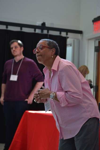 Black Theater Symposium panelist Caleen Sinnette Jennings (foreground) instructing attendees to read from their writings one line at a time. (Background: Attendee, Eric Swartz) (Joe Duffy/Bloc Reporter)