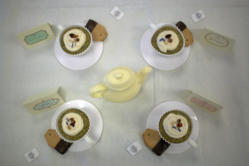 Jacky de la Torre won Best in Show for this scene from Lewis Carroll's novel, Alice's Adventures in Wonderland, in her creation made of teacup cakes, teabag cookies and a white chocolate tea kettle during the Edible Book Festival in Hornbake Library on April 1st, 2016.