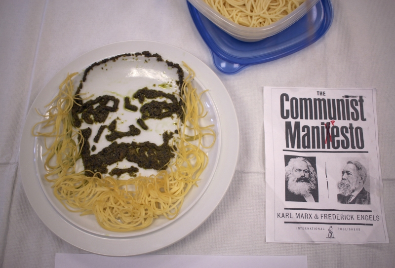 "Joy Shen depicts Karl Marx with pesto and pasta in ""Communist Manipesto"" during the Edible Book Festival in Hornbake Library on April 1st, 2016."