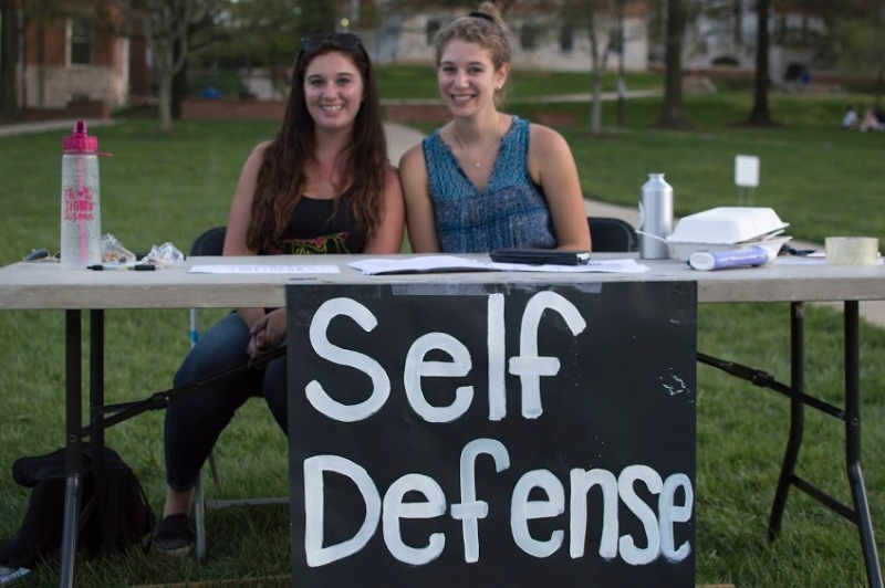 Sophomore psychology majors Molly Higgins (left), and Suzanne Woller (right) of Phi Sigma Sigma distributed information about free self defense courses to attendees at Occupy McKeldin. Higgins is Phi Sigma Sigma's risk manager and Woller is their community service chair. (Cassie Osvatics/Bloc Reporter)