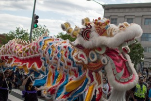 D.C. group Hung Tao Choy Mei Lucky Lions perform a traditional Chinese Dragon Dance as they marched through the D.C. Funk parade. The group also performed at the Black Broadway stage twice throughout the parade. (Cassie Osvatics/Bloc Reporter)