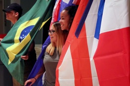 Freshmen Lidia Hernandez, biology major, and Joelle Latorre, hearing and speech major, pose with flags at the Latinx Heritage Month Opening in Stamp's Colony Ballroom, on Thursday, September 15, 2016. (Emilie Fluette/Bloc Photographer)