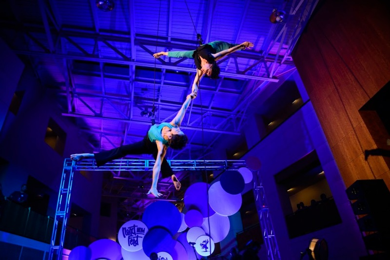 Bandaloop perfromers Damara Vita Ganley and Rachael Lincoln tumble and dance through the air inside the grand pavillion at The Clarice. (Josh Loock/Bloc Reporter)